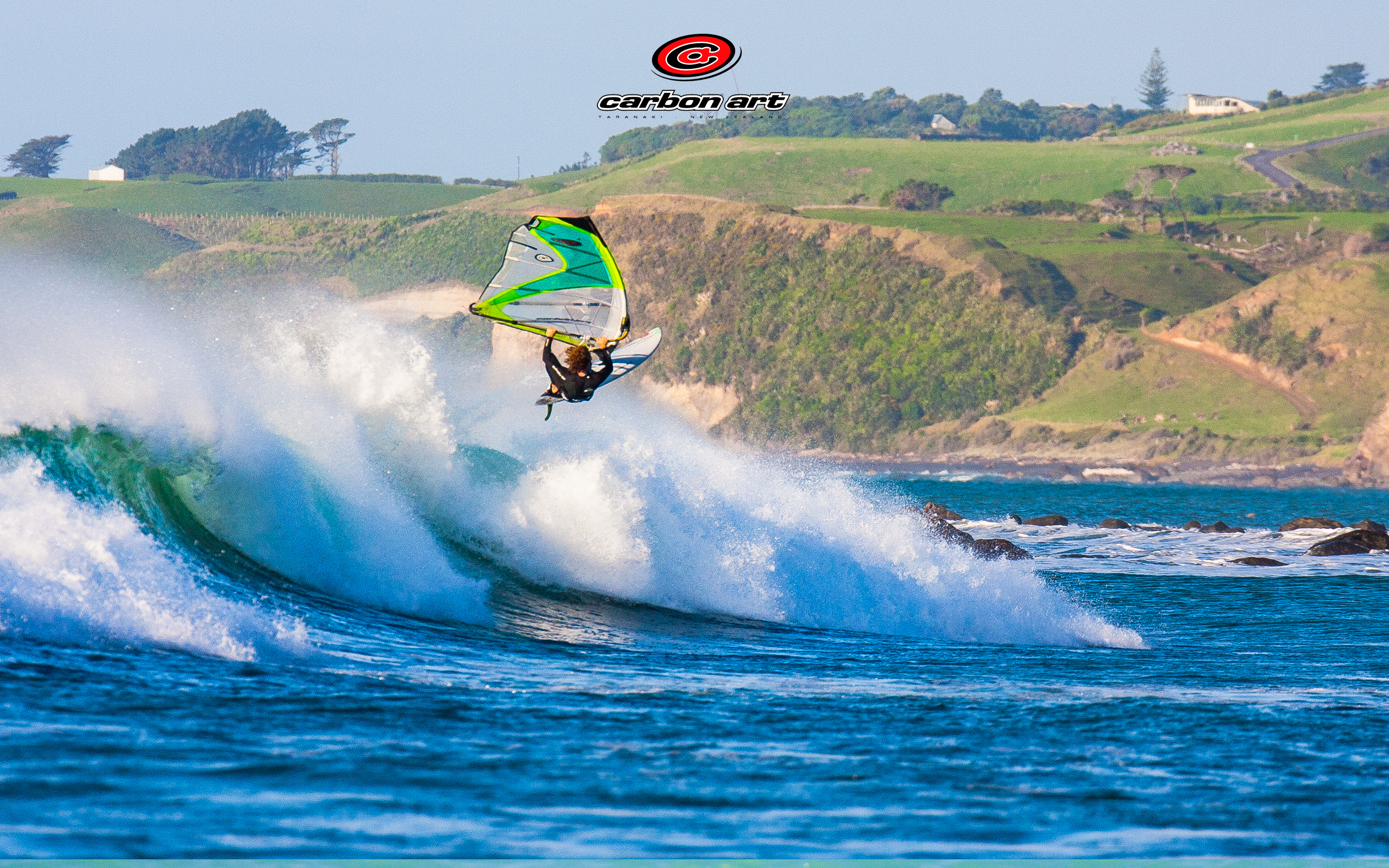aerial windsurf jump with new zealand countryside background